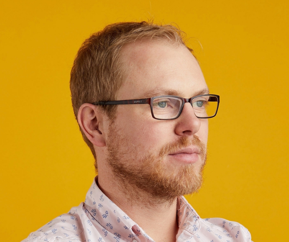 Image of Andrew Hayward with yellow background